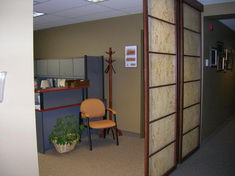 Executive offices with custom sliding screens